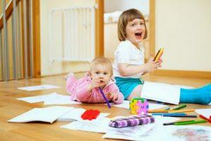 cheerful children plays in home interior